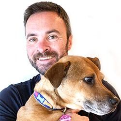 Alex Schenker with Lily dog