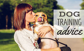 Woman holding dog kissing face (caption: Dog Training Advice)