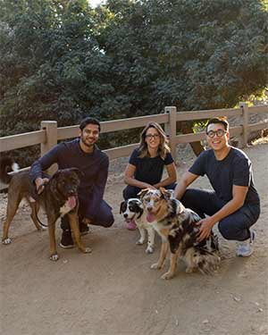 Jinx dog food co-founders with dogs