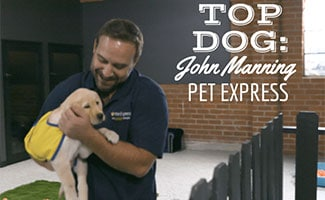 John Manning, General Manager At Pet Express holding puppy
