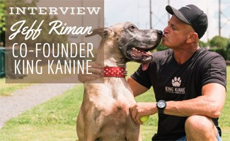 Jeff Riman kissing his Great Dane Mojo