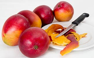 Mangoes with knive