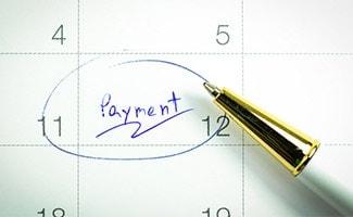 """Pen circling """"payment"""" on calendar"""