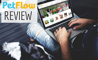 Man shopping on PetFlow's website on laptop with dog in lap (caption: Petflow Review)